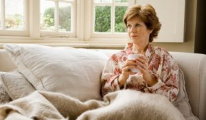 Woman on couch holding mug
